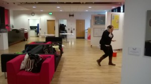 Chief Digital designer Rhiannnon Tate running from the camera during the Degree show set-up